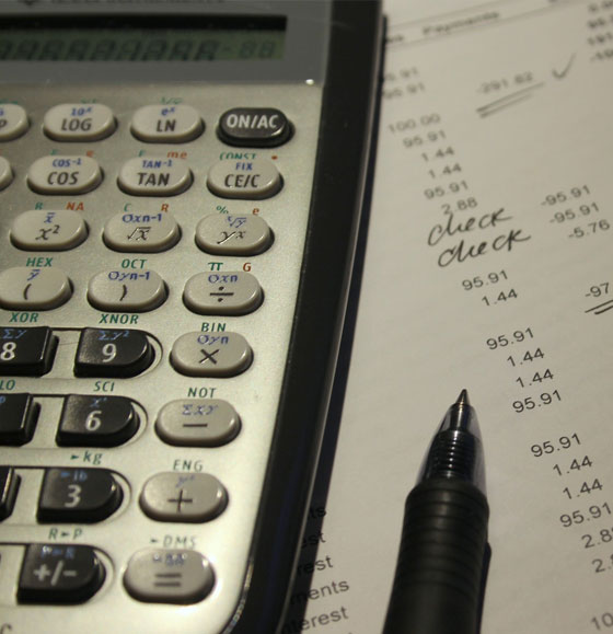 Up close view of calculator and accounting for loan modification.